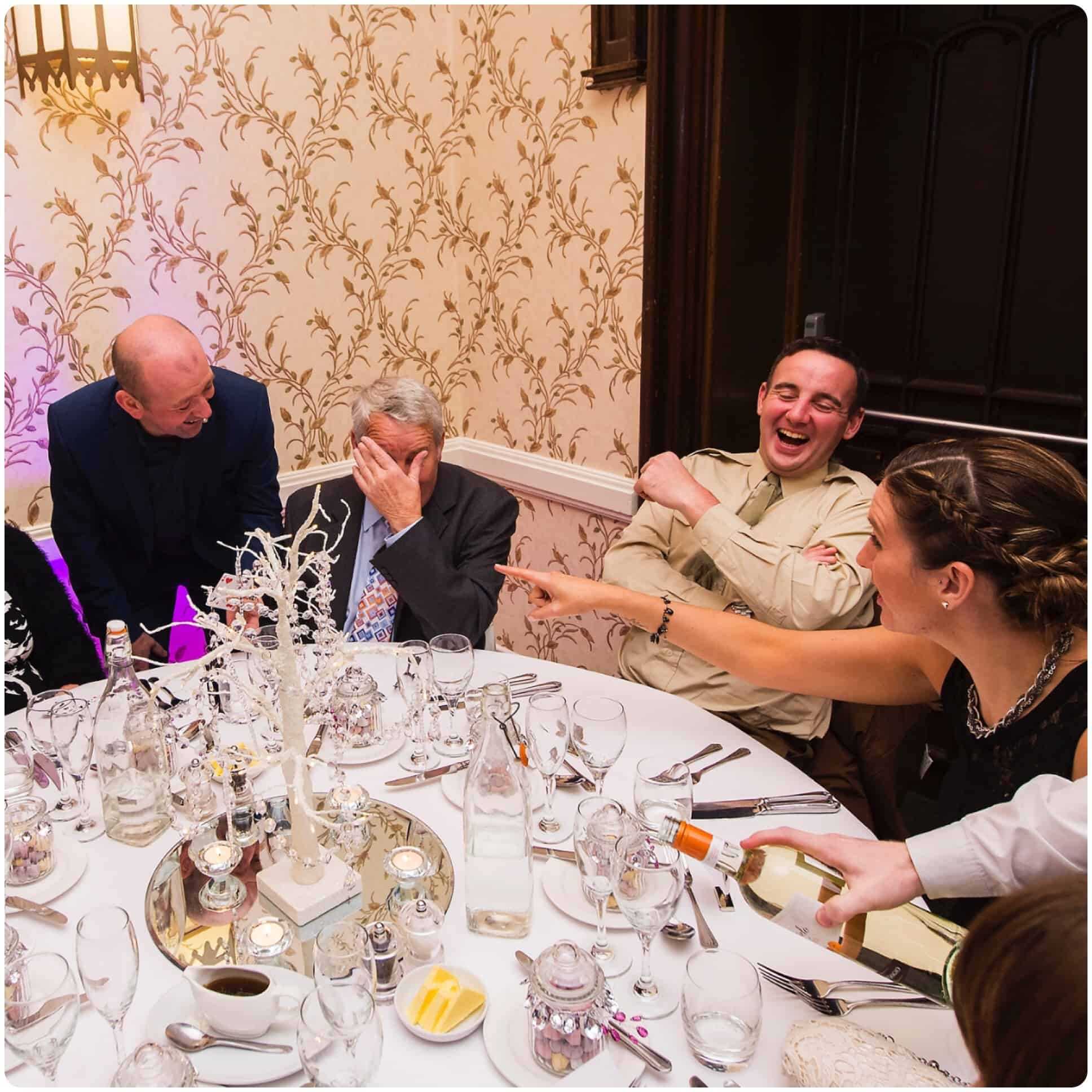 Will Gray performing magic for a table of ten guests at a wedding breakfast in Shrewsbury