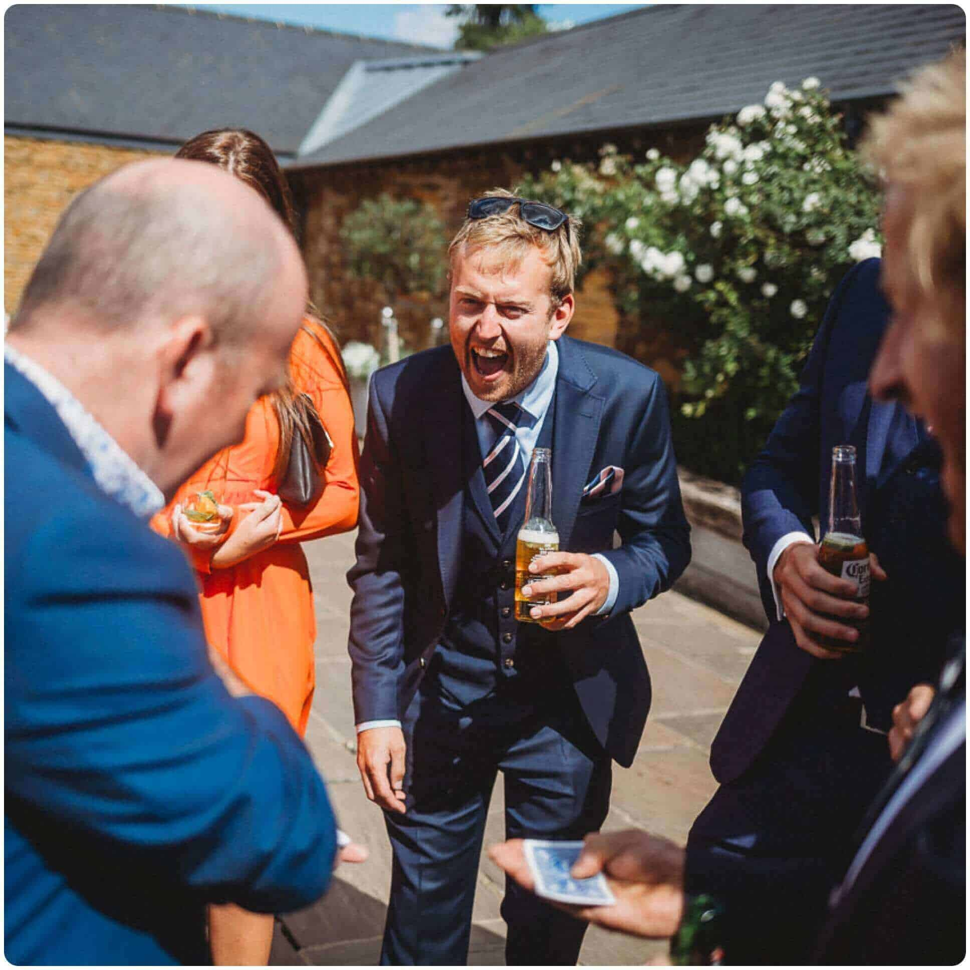 Will Gray performing magic for outside guests at a wedding in Yorkshire